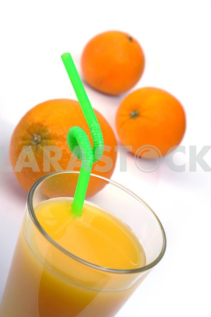 Glass of fresh orange juice and fruits — Image 19417