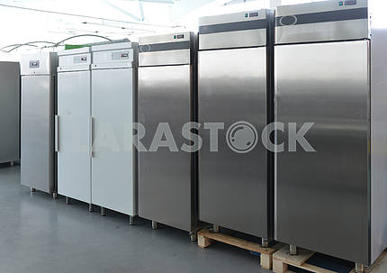 Rows of modern fridges in a store