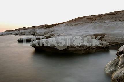 White rocks protruding into the sea