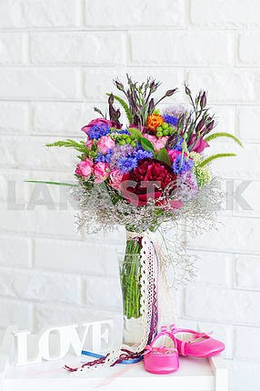 flower bouquet and  baby shoes
