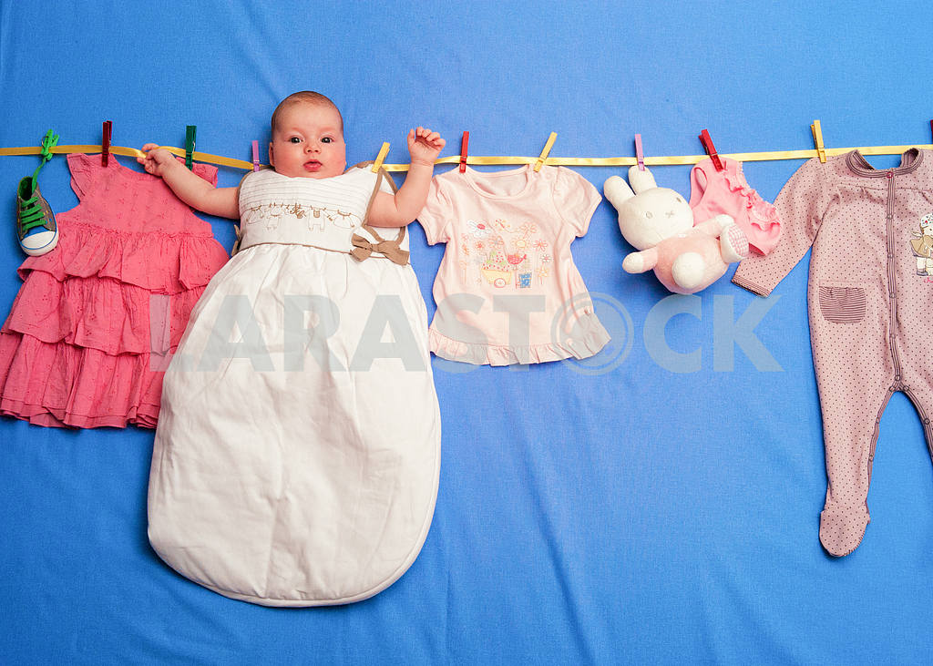 Baby in a sleeping bag is hanging on a rope — Image 2147
