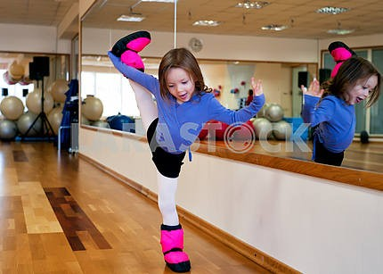Child doing gymnastics