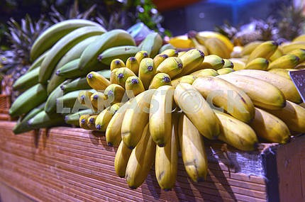bananas on display in a supermarket