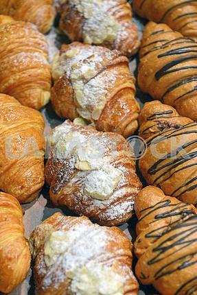 croissants on a shelf pastry shop