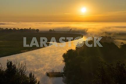 Sun and fog over the Desna. The village of Mezin. Chernihiv region