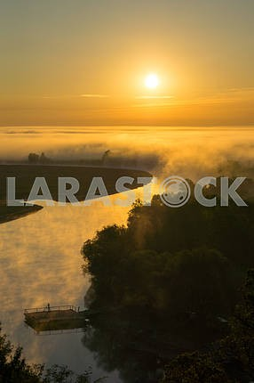 The sun and fog over the river Desna. The village of Mezin. Chernihiv region