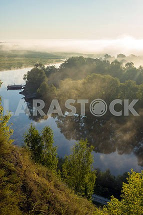 Desna River and the boat away. The village of Mezin. Chernihiv region