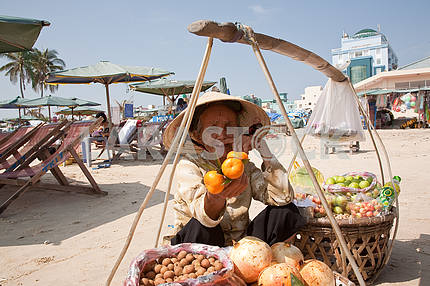 Grandmother - a saleswoman fruit