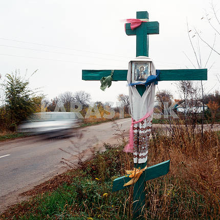 Orthodox cross before entrance to the village