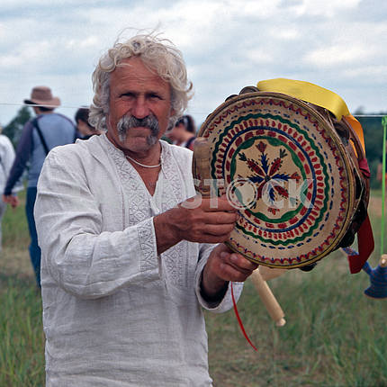 Musician with a tambourine. Ukraine