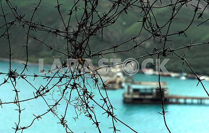 Behind barbed wire. Abandoned military base