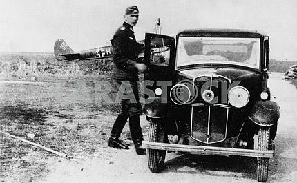 German soldier near Morris-8 car.