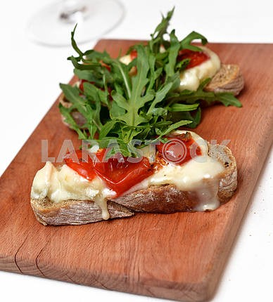 Bruschetta with cheese and pepper