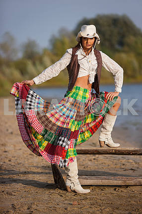 Gypsy woman wearing cowboy hat