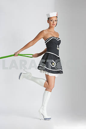 Beauty pinup girl in a sailor suit rope pulling