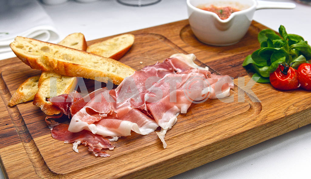 Bacon, smoked ham on a wooden board — Image 2271