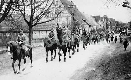 German procession. In the foreground of the cavalry