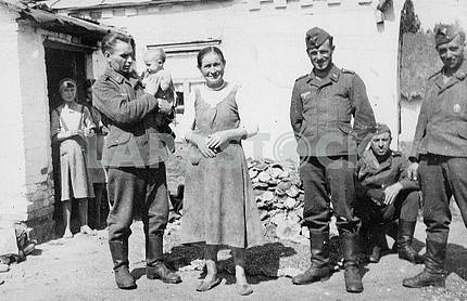 German soldiers with native people of occupied country.
