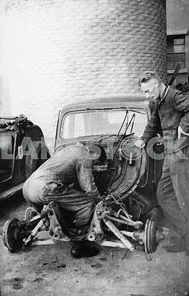 German mechanic repairing a car