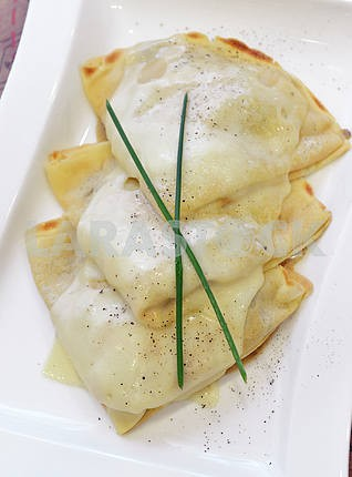 Crepes with cheese and white mushroom