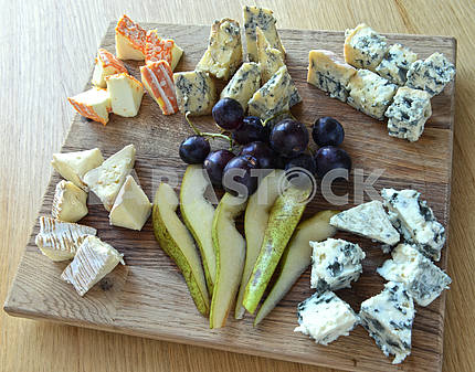 set of cheese with mold on a wooden board