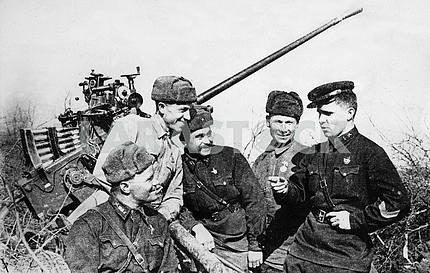 Soviet flak gun and its crew.