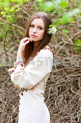 Portrait of beautiful girl in spring