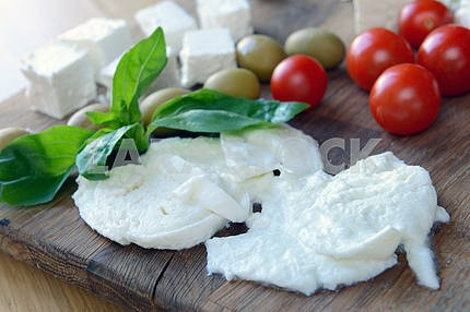 Mozzarella cheese, feta, tomatoes and basil