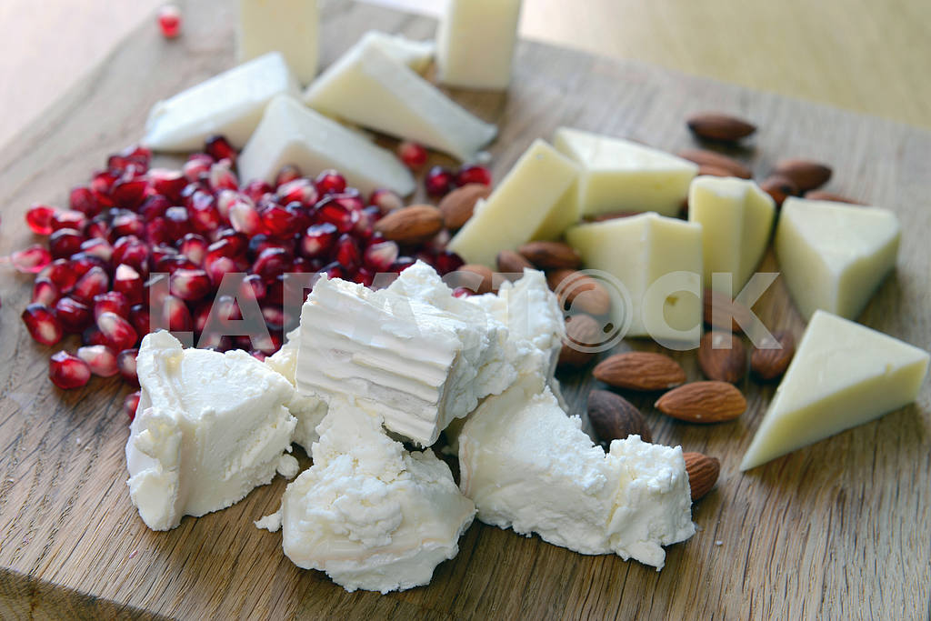 Set of goat cheese on a wooden board  — Image 2375