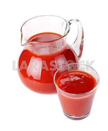 Jug and glass of tomato juice