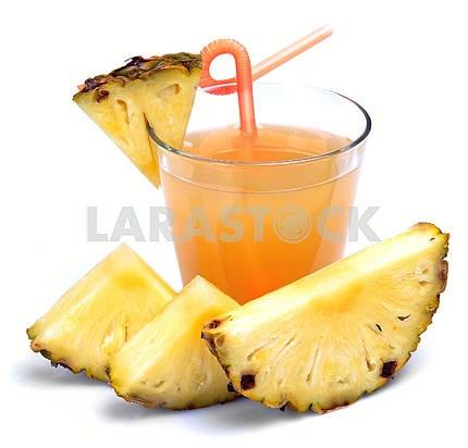 glass of fresh pineapple juice and pineapple