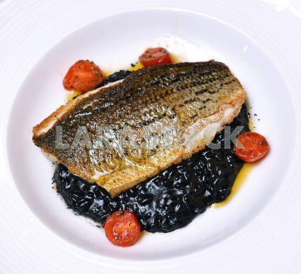 Sea bass (black sea bass) served with black risotto