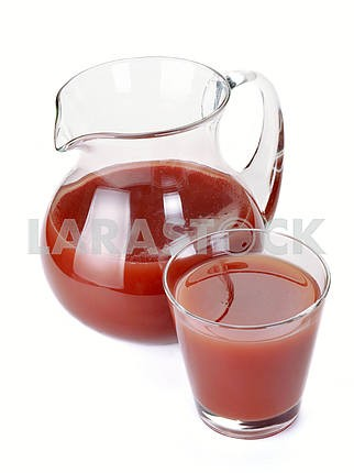 Plum juice in a jug and a glass