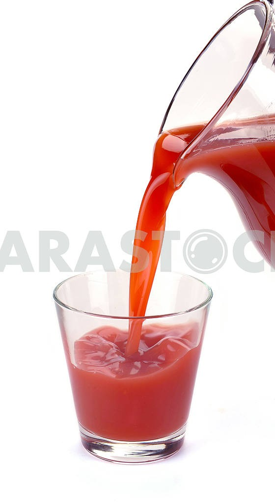 Plum juice is poured from a jug — Image 2538