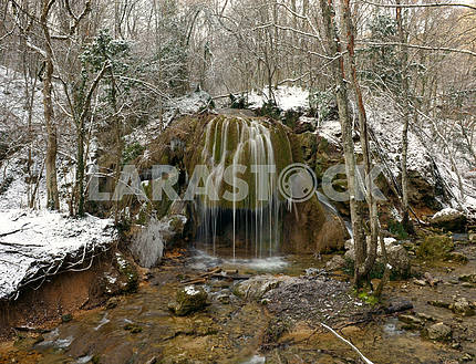 Falls in the winter forest