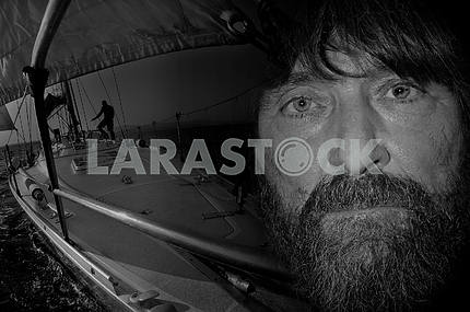 Fedor Konyukhov on the background of yachts