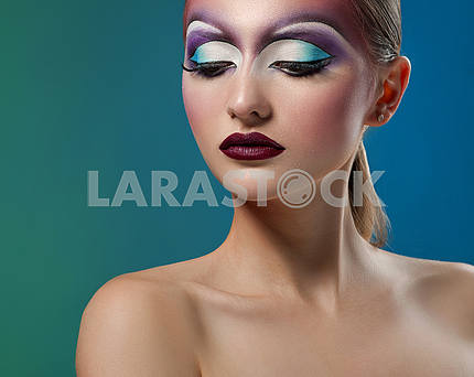 Female wearing art makeup studio shots