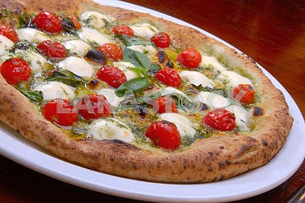 Pizza with tomatoes and cheese a mozzarella