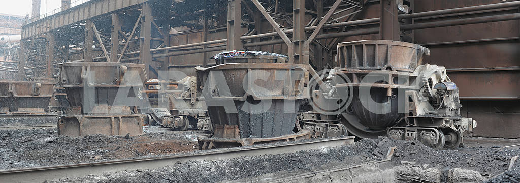 Ladles for slag on a railway platform