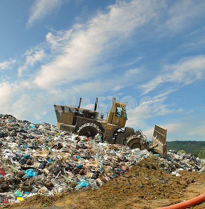 The bulldozer on a garbage dump