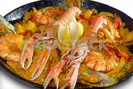 Paella with seafood in a frying pan