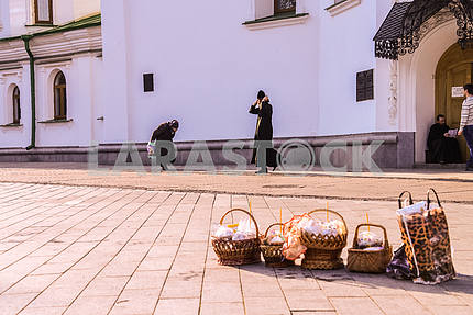 Easter baskets, grandmother and a priest