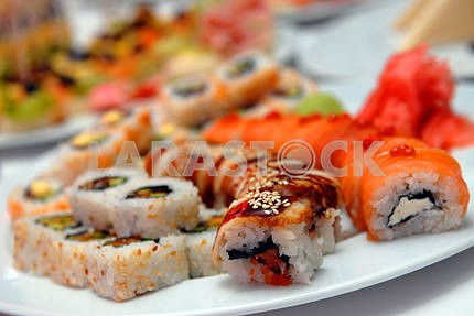 It is a lot sushi on a celebratory table