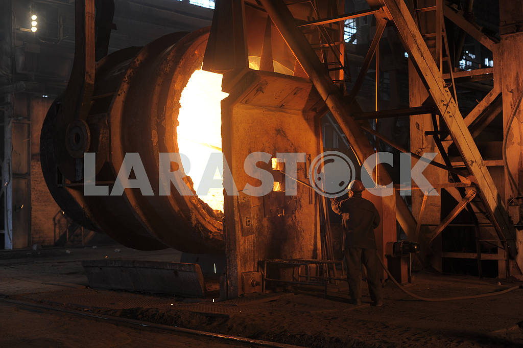 A steel worker takes a sample at steel company — Image 2936