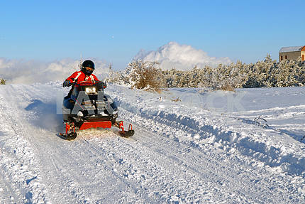 The man goes on a snowmobile