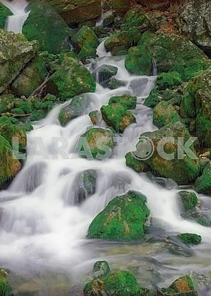 Falls among green stones