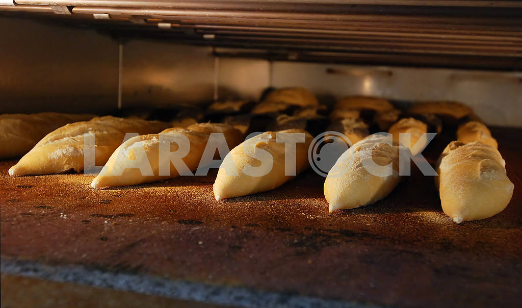 Bread long loafs are baked in the furnace — Image 2988