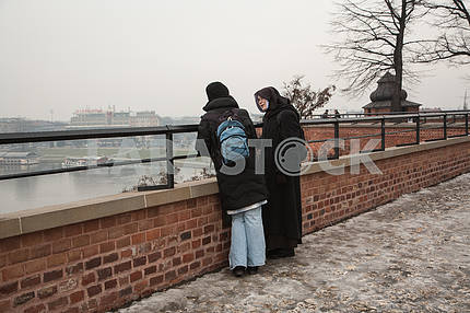 The nun speaks with a parishioner at the Wawel Hill