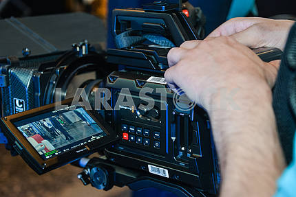 Camcorder with operator's hands.