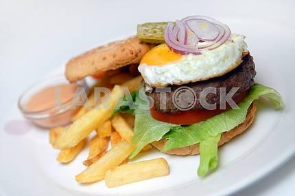 Hamburger with a fried potato